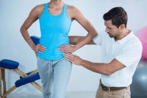 Hip Pain professional assessing pelvic movement