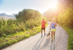 senior couple running with hip pain