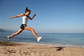 girl overstraining when running on beach
