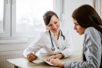 Charming female doctor discussing treatment options with her patient