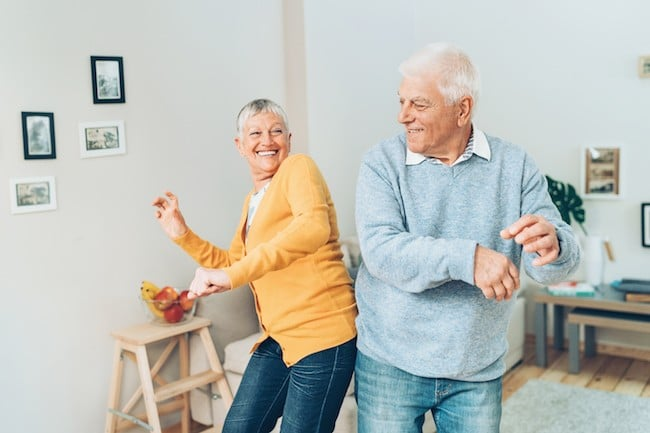 Senior couple dancing at home 650