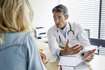 doctor explaining possible MRI finding of an acute hip flexor strain on tablet
