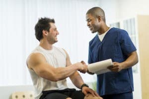 physical therapist helps man with hip pain or pelvic pain