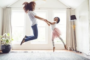 child with no hip pain and mum jumping on a bed
